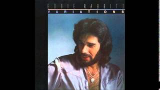 Watch Eddie Rabbitt Caroline video