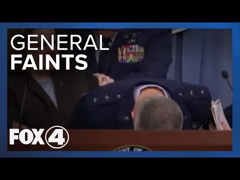 General Faints At The Podium