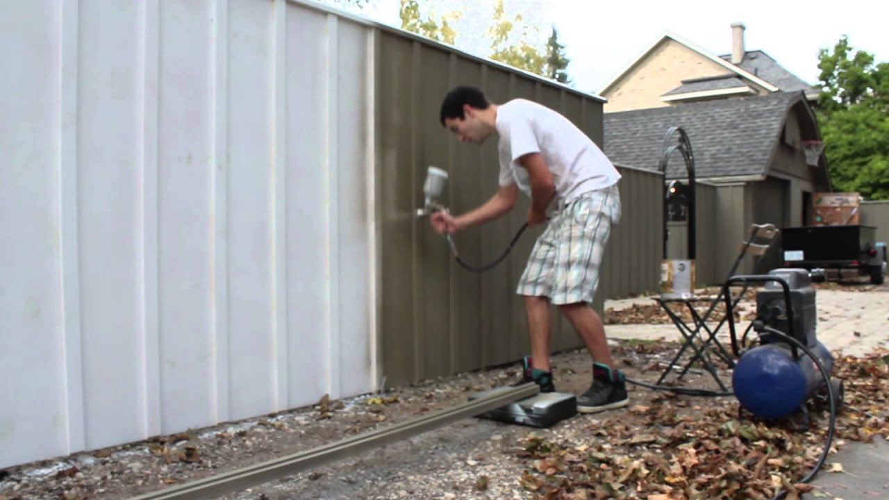 Painting A Fence With An Air Spray Paint Gun Solid Oil