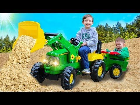 Children assembled and fixed the tractor John Deere | Toys 2 Boys