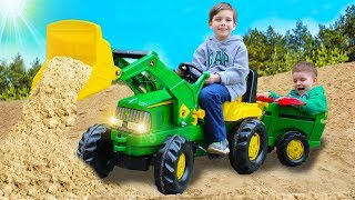 Kids assembled and fixed the tractor John Deere | Toys 2 Boys