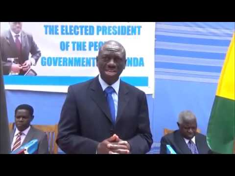 Dr. Kizza Besigye, beats Security, sworn in as President of the Republic of Uganda