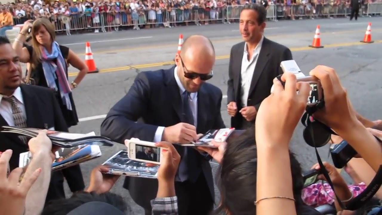 03b44219d42 Jason Statham signs autographs at the World Premiere of