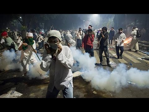 Mass rally against Jakarta's governor turns violent - world