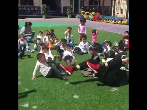 G. Cole Teaches Chinese Youth How To Exercise