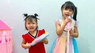 My little baby and her sister Pretend to be Singers with the new Singer Play Set