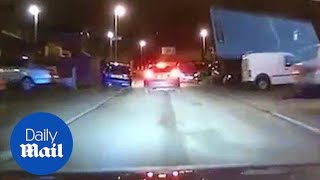 Dashcam captures police car chasing car thief in Manchester - Daily Mail