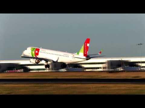 TAP Express Embraer 190 landing Lisbon Airport CS-TPO