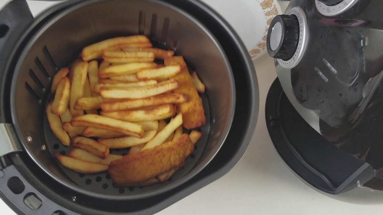 Air fryer cooking frozen chips fish fingers youtube for Air fryer fish and chips