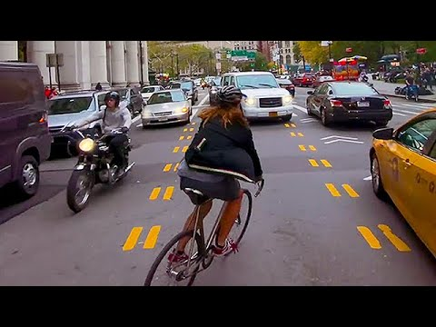 Bike Messenger Riding Fast and Fluid Through NYC Traffic
