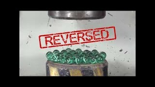 200 Tons Hydraulic Press vs 200 Glass Balls but in REVERSE