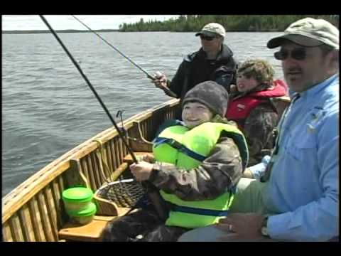 Kids Show Their Parents How To Catch Large Fish at Esnagami Lodge