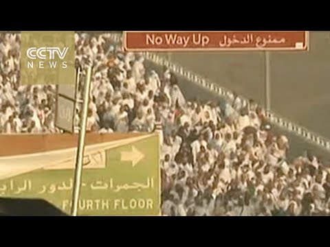 Why do millions of Muslims gather in Mecca each year?