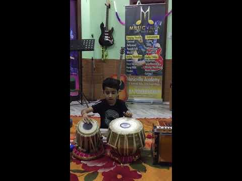 Music academy in jalandhar . Musicvilla academy's student play many instruments in Age of 6