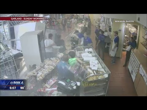 Driver racing for a parking space crashes through bakery full of customers