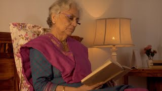 An old Indian woman reading a book wearing spectacles