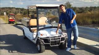 2 passenger utility dump street legal golf cart   from moto electric vehicles