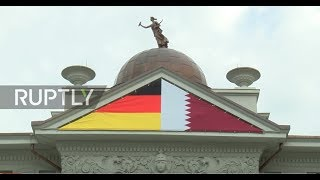 Germany: Cover up! Qatari Embassy in Berlin hides relief of nudes with flags