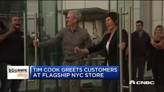 Apple CEO Tim Cook greets customers at renovated New York Apple Store