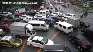 Heavy traffic, flooding due to monsoon rains in Quezon City