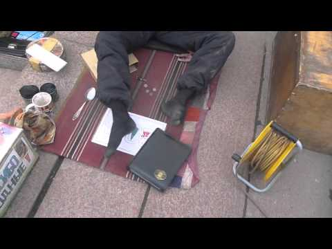 Street Artist who draws with his feet in Bishkek   Kyrgyzsta