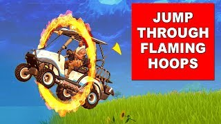 Jump through Flaming Hoops with a shopping cart or ATK - Fortnite Season 5 Week 4 Challenges