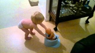 Emilla takes her doll to potty training