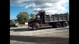 Dump Trucks at the Asphalt Silo