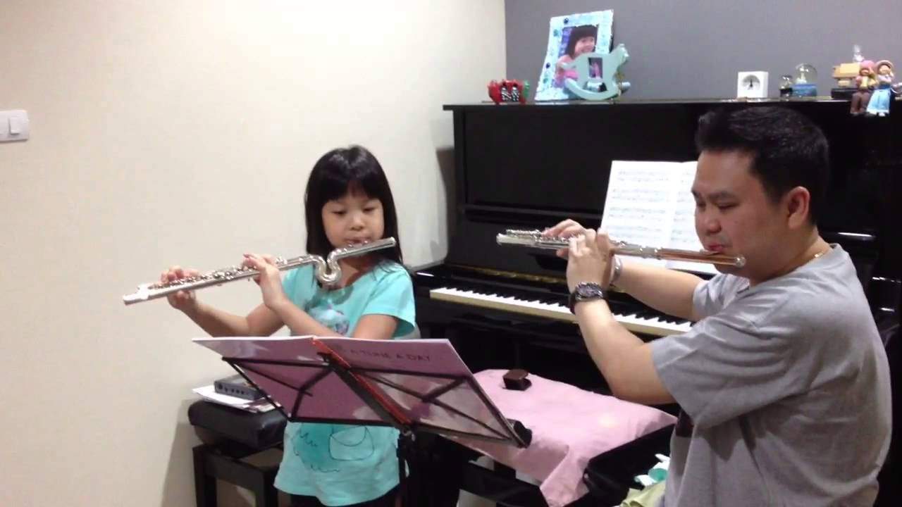Erika plays duet lesson for flute with her teacher.