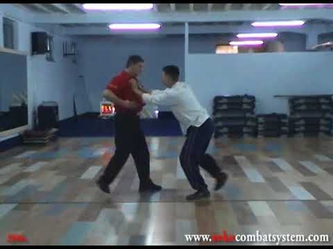 Soko Combat System - Tonfa 7 CQC - 2 hand grab to the chest defense 3