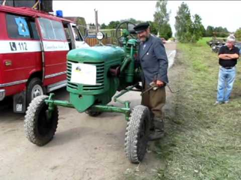 Old tractor HTZ-7. Starting and riding