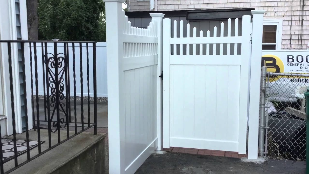 White Vinyl Fence with Open Top Step Down Spindle installed by Done