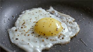 Close up shot of egg cooking on hot pan