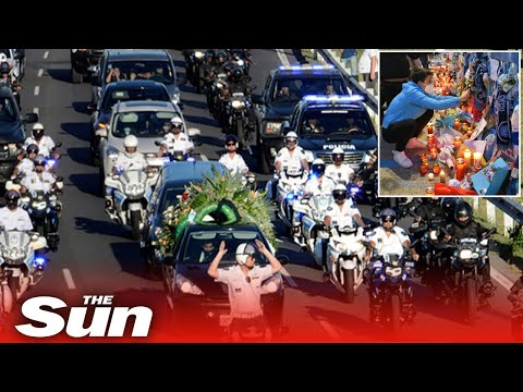 Mourners clash with police as Diego Maradona's coffin is driven to the football legend's funeral
