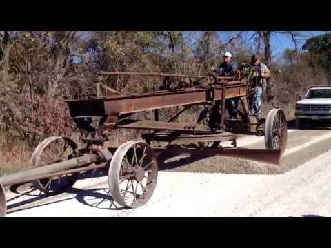 Frick steam engine pulling road grader