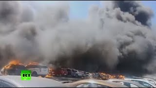 Hundreds of cars catch fire at air show in India