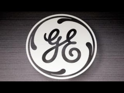 GE slashes dividend in half
