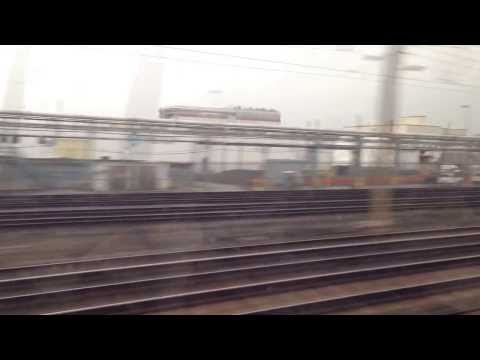 ACELA @ 106 Mph through an Industrial Area and crossing a NYC bound commuter train