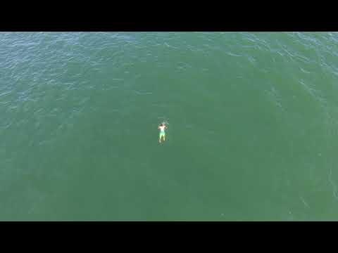 Drone video released of man swimming from Surf City Police