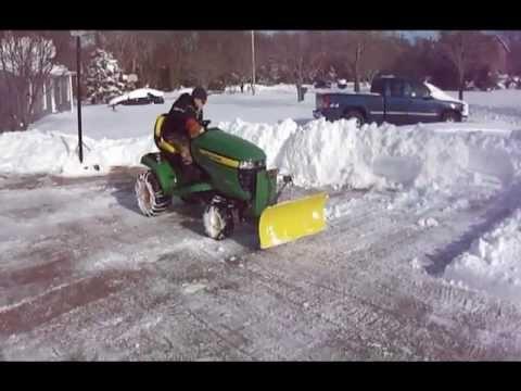 John Deere X320 Snow Plowing