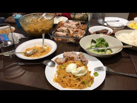 Mukbang eating Filipino food palabok, lechon and Sinigang