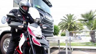 Volkswagen Motorsport - Jost Capito and his Ducati bike(Volkswagen Motorsport director Jost Capito is Rally Italia, drives a Ducati bike and Interview., 2014-06-07T22:47:54.000Z)
