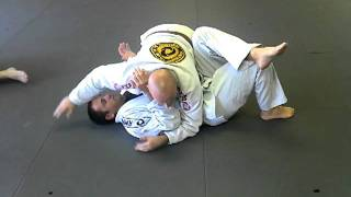 Side control inside armlock defense