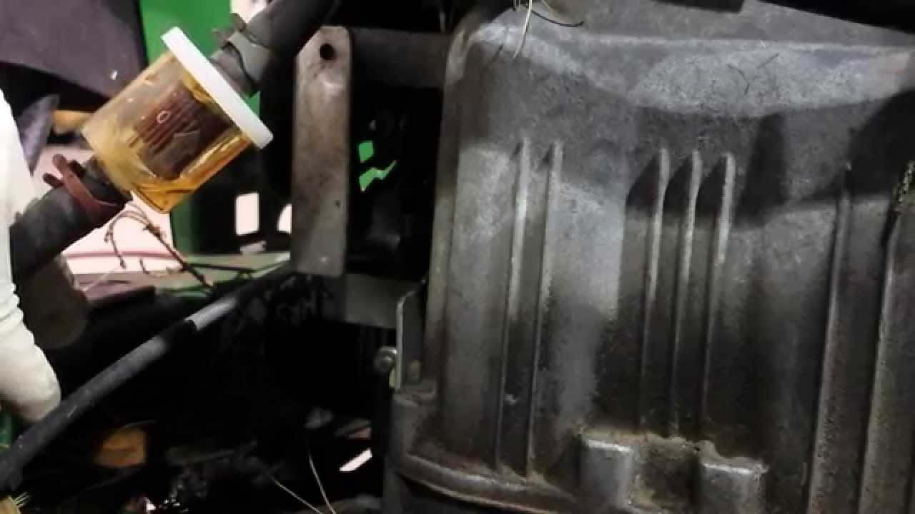 how to change a fuel filter on a john deere 225 0 turn with one hand [ 1280 x 720 Pixel ]