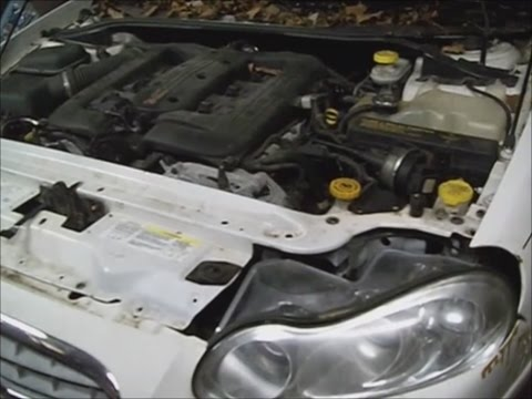 Chrysler Concorde  `03 w 3.5l H.O. timing belt and water pump remove pt1