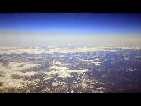 aerial view of winter snow on high altitude mountains birds eye view on the plane e7ot1psfe