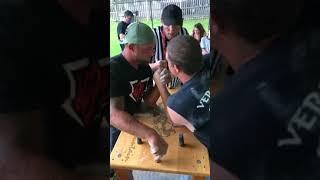 Team mates Eric & Big Jake arm wrestle