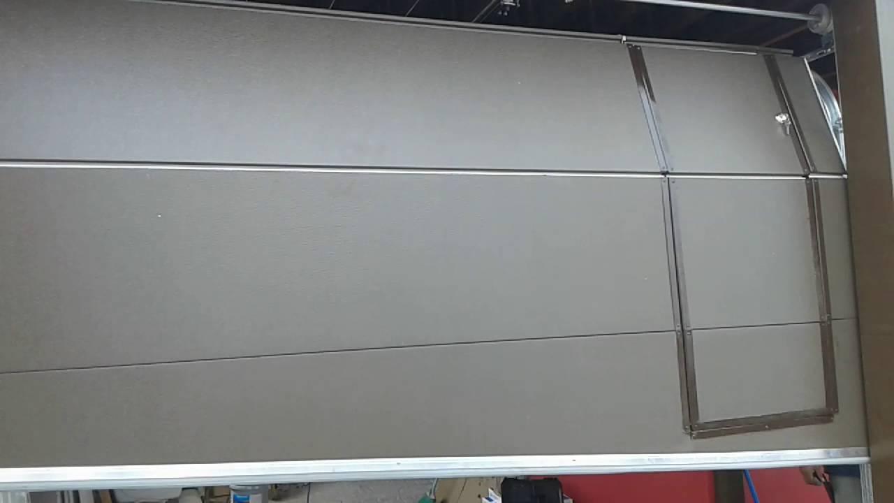 Puerta electrica de garage seccional con acceso peatonal - Puertas para cocheras ...