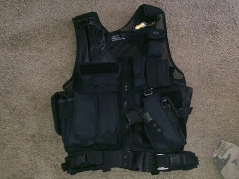 black-tactical-vest-with-side-draw-holster-and-11-pouches..$40.00-on-amazon