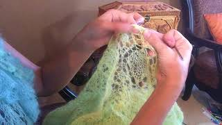 Inserting elastic into knitted garment with crochet hook